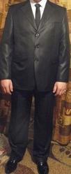 Продается отличный новый мужской костюм черного цвета.